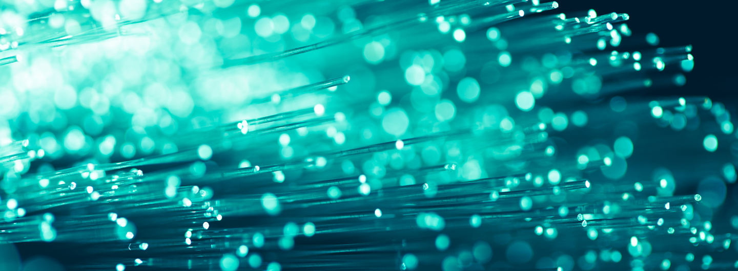 A picture of lights and fibre optic cables, representing business internet