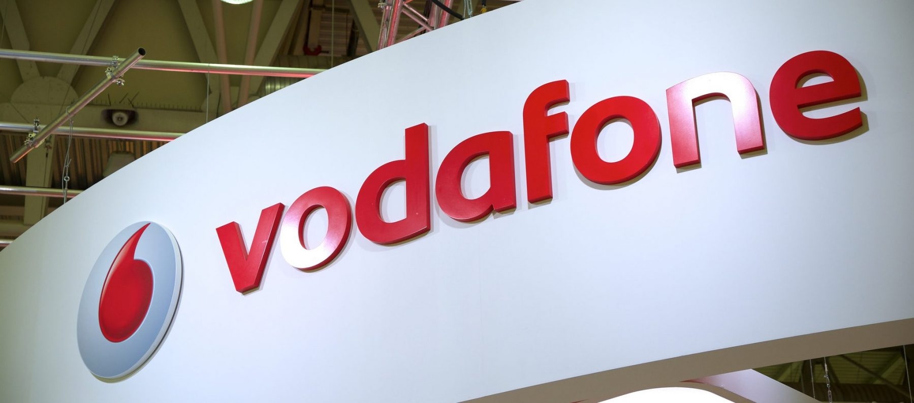 A Vodafone sign at an exhibition