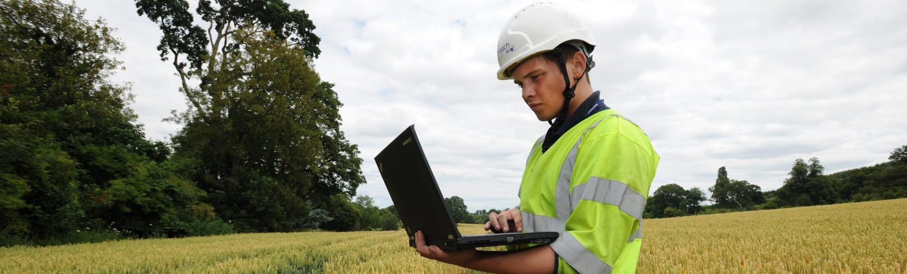 BT OpenReach engineer in a field