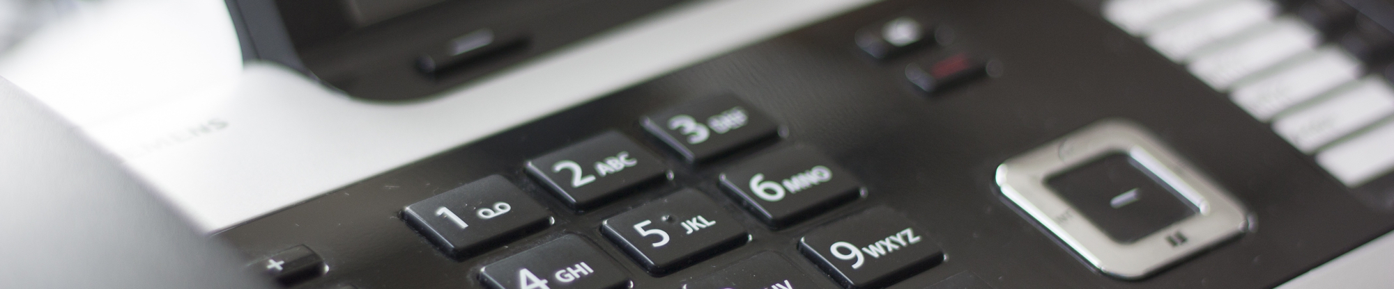 A cropped photo of a telephone, centred on its number pad